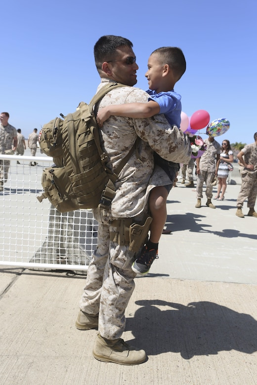 A Marine returning from deployment reunites with his son aboard Marine Corps Air Station Miramar, Calif., April 4. Service members from Marine Wing Support Squadron (MWSS) 372, Marine Medium Tiltrotor Squadron (VMM) 363 and Marine Aviation Logistics Squadron (MALS) 16 returned from a six and a half month deployment with the Special Purpose Marine Air-Ground Task Force – Crisis Response – Central Command in support of Operation Inherent Resolve. (U.S. Marine Corps photo by Lance Cpl. Harley Robinson/Released)