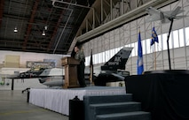 Air Force Col. Michael P. Winkler, the 354th Fighter Wing commander, announces the Secretary of the Air Force's signed decision to select Eielson Air Force Base, Alaska, as the location of the Air Force's first F-35A operational base in the Pacific Air Forces' Area of Responsibility during an April 4, 2016, ceremony at Eielson. Basing the F-35s at Eielson will allow the Air Force the capability of using the largest airspace in the Air Force in the Joint Pacific Alaska Range Complex for large-force exercises, ensuring realistic combat training for the Department of Defense. (U.S. Air Force photo by Master Sgt. Karen J. Tomasik/Released)