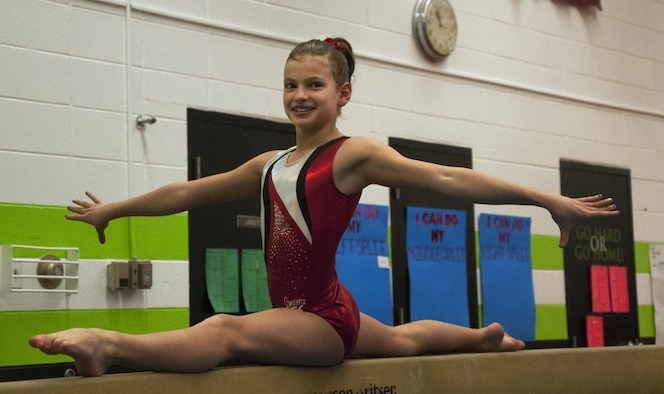 Emma Brittingham, 12, daughter of Lt. Col. Jacob Brittingham, 37th Helicopter Squadron, executes a left split on a balance beam April 2, 2016, in Cheyenne, Wyo. Emma recently won the level-8 state gymnastics competition and will be representing Wyoming in a regionals competition on April 15. (U.S. Air Force photo by Senior Airman Brandon Valle)