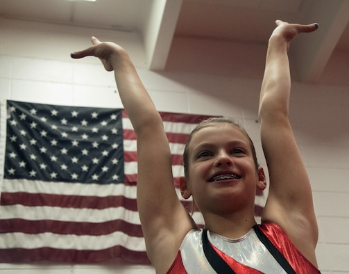 Emma Brittingham, 12, daughter of Lt. Col. Jacob Brittingham, 37th Helicopter Squadron, poses April 2, 2016, after practicing gymnastics in Cheyenne, Wyo. Emma recently won the Wyoming level-8 state gymnastics competition and will be representing Wyoming in a regionals competition on April 15, 2016. (U.S. Air Force photo by Senior Airman Brandon Valle)