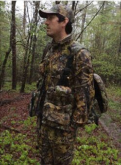 Aaron Murphy, a Savannah Corps forester, observes an area of activity during Thurmond Lake's Turkey Hunt  April 1 held at Bussey Point Management Area. The annual event offers a handful of hopefuls the chance to hunt Eastern Wild Turkeys who inhabit the isolated stretch of forest.