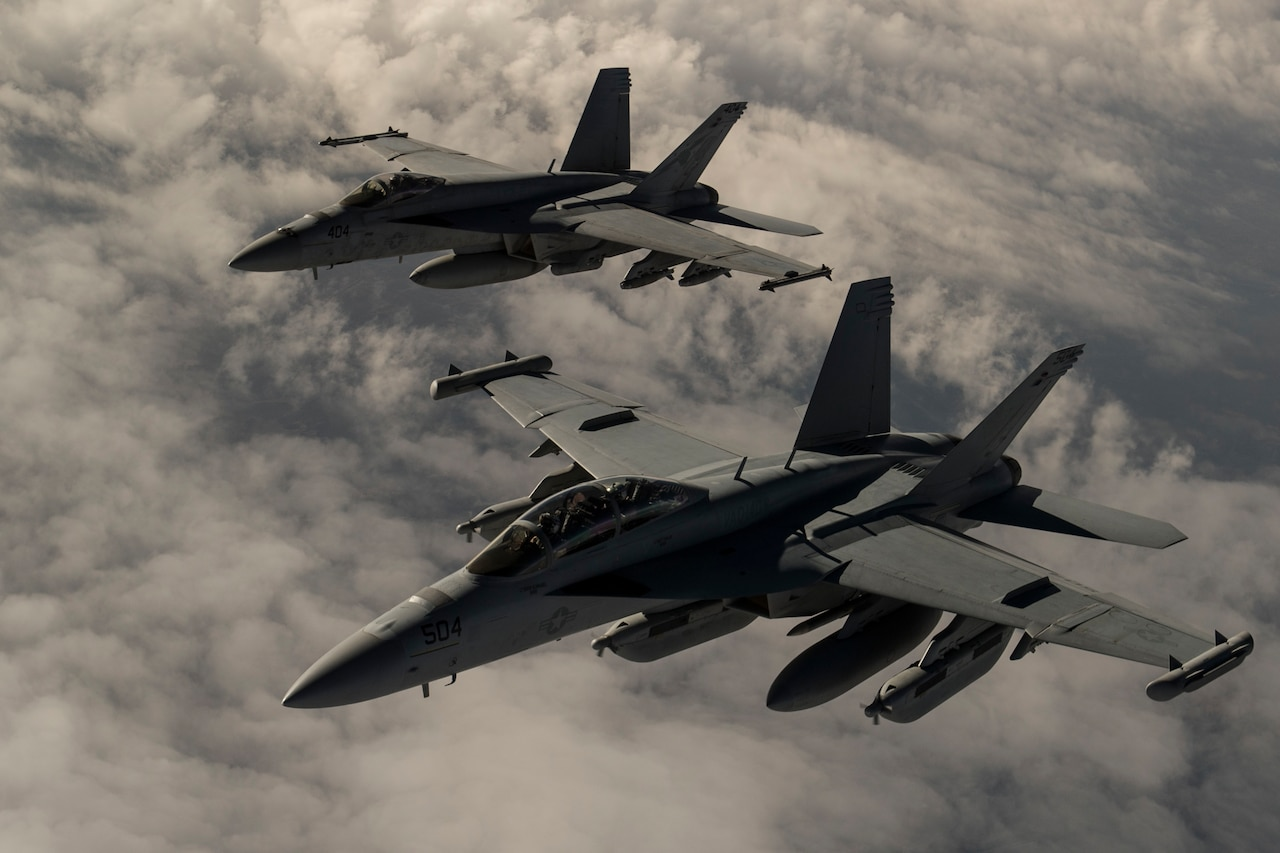 U.S. Navy F-18 Hornet fighters fly over Iraq, March 3, 2016. Army Col. Steve Warren, the spokesman for Operation Inherent Resolve, briefed reporters from Baghdad today about the progress of the counter-ISIL coalition and its partners on the ground in Syria and Iraq. Air Force photo by Staff Sgt. Corey Hook