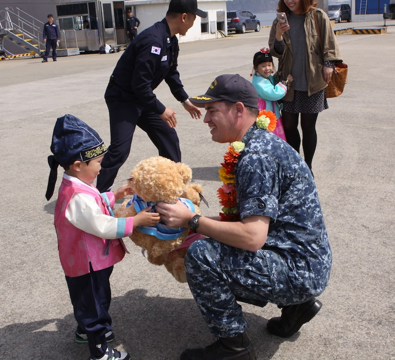 160406-N-WO381-023 CHINHAE, Republic of Korea (April 06, 2016)  Cmdr. Michael Beckette, commanding officer of USS Tucson (SSN 770) gives a teddy bear to a local child during a gift exchange. Homeported in Pearl Harbor, USS Tucson is the 59th Los Angeles-class attack submarine and the 30th of the Improved Los Angeles-class attack submarines to be built. (U.S. Navy photo by Master-at-Arms 3rd Class Diamond Brown/RELEASED)