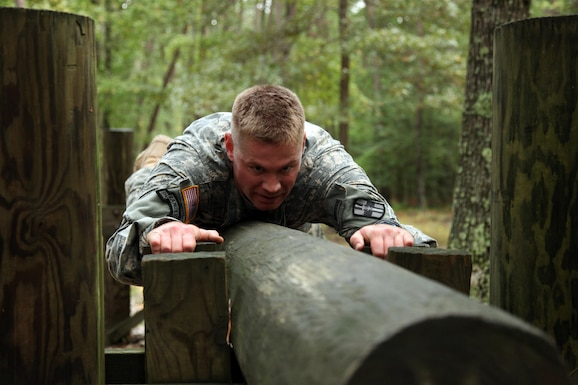 U.S. Army Staff Sgt. Andrew Fink, assigned to 409th Area Support Medical Company, U.S. Army Reserve Command, maneuvers through an obstacle during the U.S. Army's Best Warrior Competition at Fort A.P. Hill, Va., Oct. 5, 2015. The competition is a grueling, weeklong event that tests the skills, knowledge and professionalism of 26 warriors representing 13 commands. (U.S. Army photo by Pfc. Christopher Brecht/Released) #BestWarrior