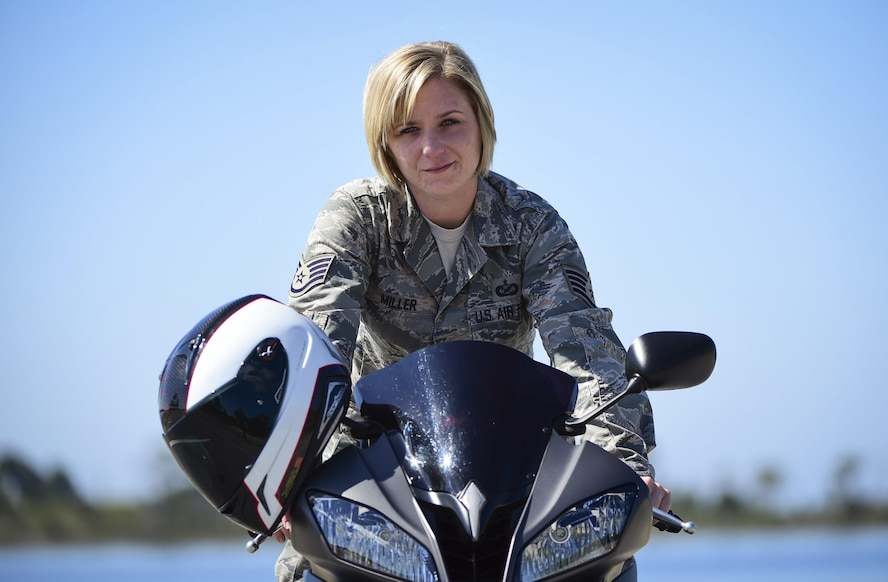 Staff Sgt. Marleah Miller, a photojournalist with the 1st Special Operations Wing Public Affairs, poses for a photo on her 2013 Yamah R6 motorcycle at Hurlburt Field, Fla., April 7, 2016. (U.S. Air Force photo by Staff Sgt. Christopher Callaway)