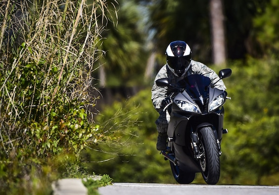 Staff Sgt. Marleah Miller, a photojournalist with the 1st Special Operations Wing Public Affairs, rides her 2013 Yamah R6 motorcycle at Hurlburt Field, Fla., April 7, 2016. (U.S. Air Force photo by Staff Sgt. Christopher Callaway)