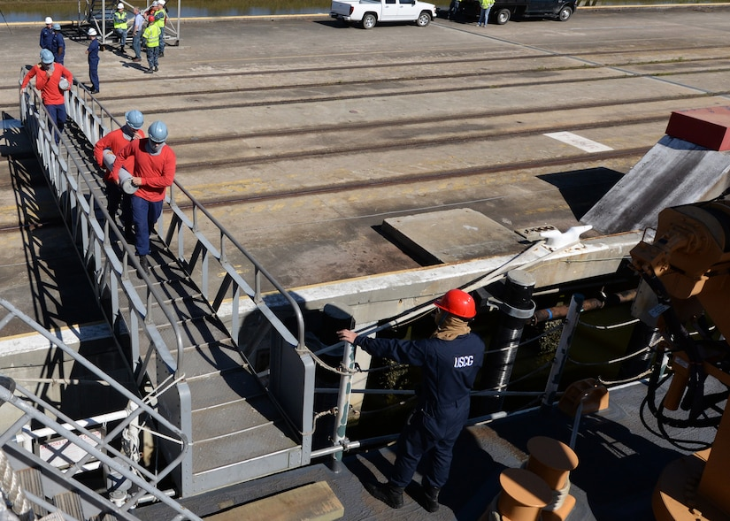 USCGC Hamilton (WMSL 753) conducts a weapons on-load at Joint Base Charleston – Weapons Station, SC, April 4, 2016. This evolution marked the first time in over 20 years that any military ship loaded weapons the JB Charleston - WS. (U.S. Navy Photo by Mass Communication Specialist 1st Class Sean M. Stafford)