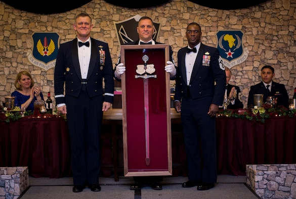 Gen. Frank Gorenc, U.S. Air Forces in Europe and Air Forces Africa commander, is presented his personal sword by Command Chiefs Samuel Simmons (center) and James Davis (right) during an Order of the Sword ceremony held at Ramstein Air Base, Germany, April 7, 2016. The Order of the Sword is a special program where noncommisioned officers of a command recognize individuals who have made significant contributions to the enlisted corps. Gorenc is the 20th USAFE-AFAFRICA commander to be awarded this honor. (U.S. Air Force photo/ Tech. Sgt. Ryan Crane)