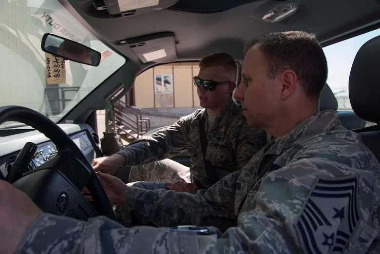 U.S. Air Force Airman Evan Fisher, 728th Air Mobility Squadron passenger service agent, demonstrates staircase truck functions to U.S. Air Force Chief Master Sgt. Mark Redden, 521st Air Mobility Operations Wing command chief, April 4, 2016, at Incirlik Air Base, Turkey. Staircase trucks are used to transit passengers on and off aircraft. (U.S. Air Force photo by Senior Airman John Nieves Camacho/Released)