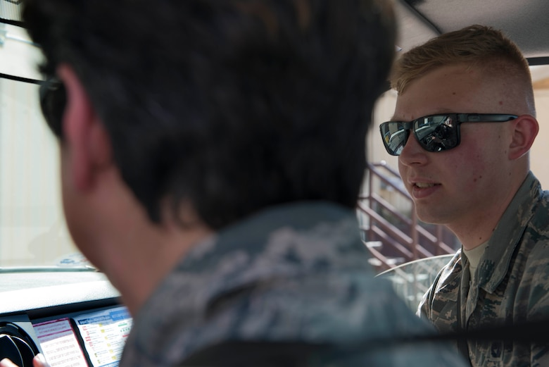 U.S. Air Force Airman Evan Fisher, 728th Air Mobility Squadron passenger service agent, monitors U.S. Air Force Col. Nancy Bozzer, 521st Air Mobility Operations Wing commander, as she operates a staircase truck, April 4, 2016, at Incirlik Air Base, Turkey. The 728th AMS is a tenant unit at Incirlik AB and falls under the 521st AMOW command, based at Ramstein AB. (U.S. Air Force photo by Senior Airman John Nieves Camacho/Released)