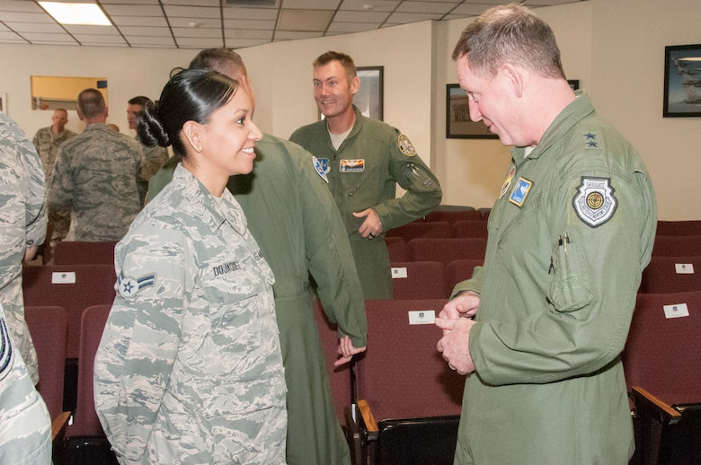 Maj. Gen. James Hecker, 19th Air Force commander, speaks with Airman 1st Class Irlanda Dojaquez from the Arizona Air National Guard's 162nd Wing during his visit March 30-April 1 to the Tucson International Airport.  The general met with members of the 162nd Wing, whose mission is to train fighter pilots from around the world.  (U.S. Air National Guard photo by 2nd Lt. Lacey Roberts/Released)