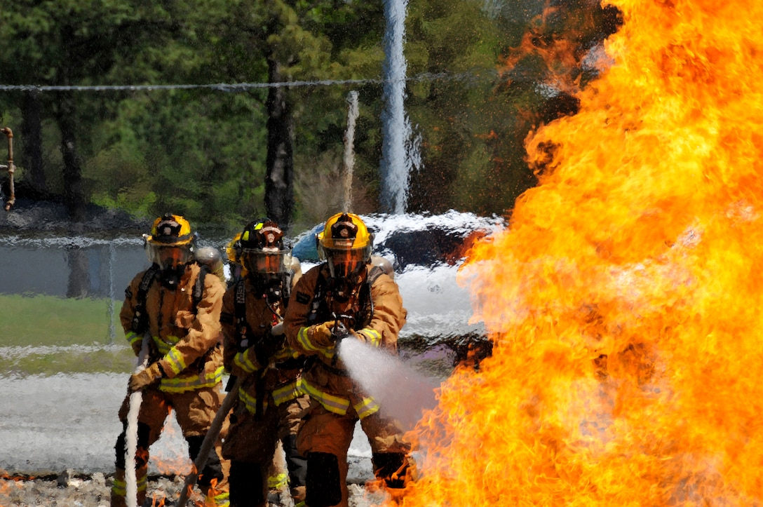 Airmen from the Connecticut, Maine, New Jersey, Rhode Island and Vermont Air National Guard Fire Departments perform a live aircraft fire training exercise at 165th Airlift Wing's Regional Fire Training Facility in Savannah, Ga. on April 4th, 2016.  The airmen are conducting joint training exercises to maintain operational readiness. (U.S. Air National Guard photo by Tech. Sgt. Andrew J. Merlock/Released)