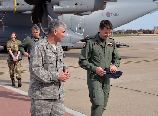 Lt. Gen. Sam Cox, 18th Air Force commander, speaks with British Royal
