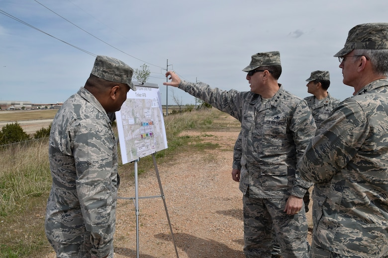 Lt. Gen. Lee K. Levy II, Air Force Sustainment Center Commander, points out key locations of the KC-46A industrial area to Gen. Paul J. Selva, Vice Chairman of the Joint Chiefs of Staff, right, after a briefing on the capacity and capability of Bldg. 9001 and the military construction plan for the new KC-46A industrial area. The briefing, conducted April 1 at the KC-46A industrial area overlook site north of Bldg. 9001, also highlighted how close community relations resulted in the Air Force being able to acquire the area.  (U.S. Air Force photo by Greg L. Davis)