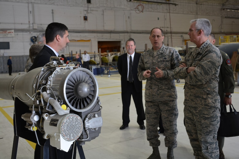 Lt. Gen. Lee K. Levy II, Air Force Sustainment Center Commander, comments during a briefing to Gen. Paul J. Selva, Vice Chairman of the Joint Chiefs of Staff, right, April 1, by Mr. John R. Sneden, Air Force Life Cycle Management Center Propulsion Sustainment Division Chief, left, on F107 engine challenges.  The F107 engine is used to power cruise missiles, the F-22 vapor cycle system and the ethyl glycol and water pumps for the B-2 bomber. Also in the photo is Mr. Charles Alley, 565th Aircraft Maintenance Squadron director.  (U.S. Air Force photo by Darren Heusel)