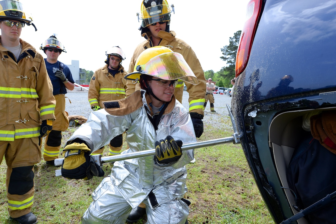 Airman 1st Class Brooke Hunt of the 177th Fighter Wing Fire Department, New Jersey Air National Guard, utilizes a halligan tool to soften a vehicle during basic vehicle extrication training exercises at the 165th Airlift Wing's Regional Fire Training Facility in Savannah, Ga. on April 6th, 2016.  Airmen from the Connecticut, Maine, New Jersey, Rhode Island and Vermont Air National Guard Fire Departments are conducting training exercises together to maintain operational readiness. (U.S. Air National Guard photo by Tech. Sgt. Andrew J. Merlock/Released)