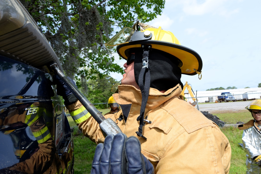 An airman utilizes a halligan tool to soften a vehicle during basic vehicle extrication training exercises at the 165th Airlift Wing's Regional Fire Training Facility in Savannah, Ga. on April 6th, 2016.  Airmen from the Connecticut, Maine, New Jersey, Rhode Island and Vermont Air National Guard Fire Departments are conducting training exercises together to maintain operational readiness. (U.S. Air National Guard photo by Tech. Sgt. Andrew J. Merlock/Released)