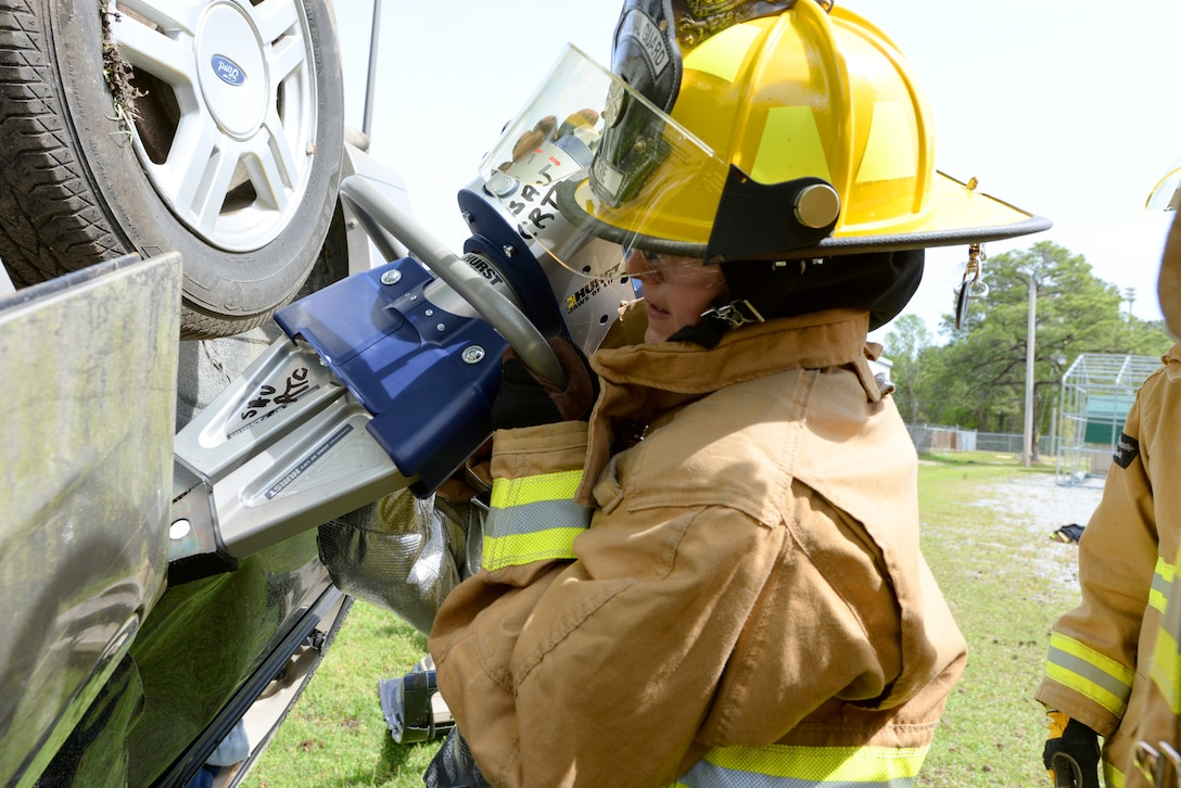 Senior Airman Katelyn Mosley of the 101st Airlift Wing Fire Department, Maine Air National Guard, utilizes a Hurst spreader to open a vehicle door during basic vehicle extrication training exercises at the 165th Airlift Wing's Regional Fire Training Facility in Savannah, Ga. on April 6th, 2016.  Airmen from the Connecticut, Maine, New Jersey, Rhode Island and Vermont Air National Guard Fire Departments are conducting training exercises together to maintain operational readiness. (U.S. Air National Guard photo by Tech. Sgt. Andrew J. Merlock/Released)
