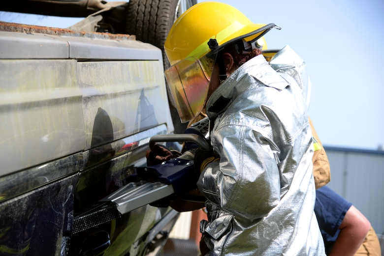 Airman 1st Class Brooke Hunt of the 177th Fighter Wing Fire Department, New Jersey Air National Guard, utilizes a Hurst spreader to open a vehicle door during basic vehicle extrication training exercises at the 165th Airlift Wing's Regional Fire Training Facility in Savannah, Ga. on April 6th, 2016.  Airmen from the Connecticut, Maine, New Jersey, Rhode Island and Vermont Air National Guard Fire Departments are conducting training exercises together to maintain operational readiness. (U.S. Air National Guard photo by Tech. Sgt. Andrew J. Merlock/Released)