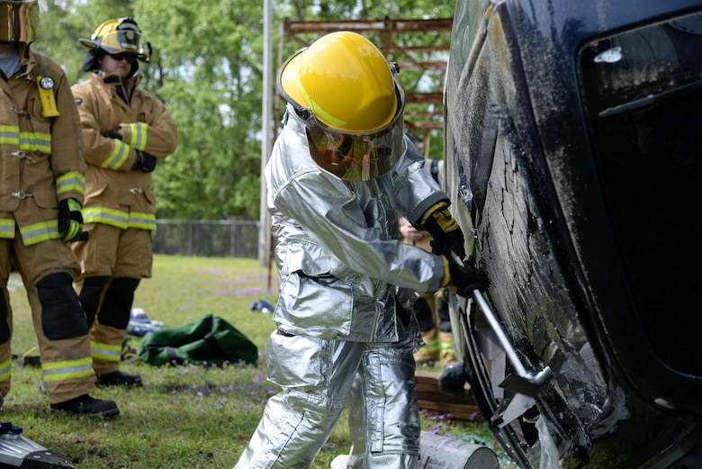 Airman 1st Class Brooke Hunt of the 177th Fighter Wing Fire Department, New Jersey Air National Guard, utilizes a halligan tool to break a vehicle window during basic vehicle extrication training exercises at the 165th Airlift Wing's Regional Fire Training Facility in Savannah, Ga. on April 6th, 2016.  Airmen from the Connecticut, Maine, New Jersey, Rhode Island and Vermont Air National Guard Fire Departments are conducting training exercises together to maintain operational readiness. (U.S. Air National Guard photo by Tech. Sgt. Andrew J. Merlock/Released)
