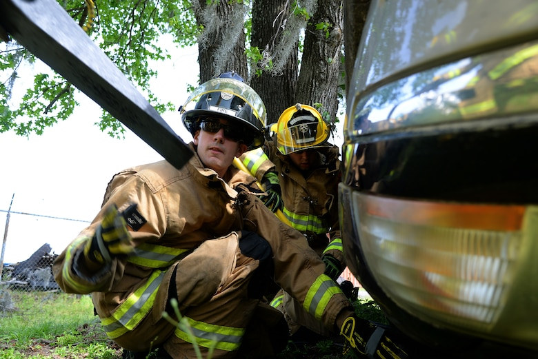 Airman 1st Class Scott Bramhall of the 177th Fighter Wing Fire Department, New Jersey Air National Guard, utilizes wedge cribbing to stabilize a vehicle during basic vehicle extrication training exercises at the 165th Airlift Wing's Regional Fire Training Facility in Savannah, Ga. on April 6th, 2016.  Airmen from the Connecticut, Maine, New Jersey, Rhode Island and Vermont Air National Guard Fire Departments are conducting training exercises together to maintain operational readiness. (U.S. Air National Guard photo by Tech. Sgt. Andrew J. Merlock/Released)