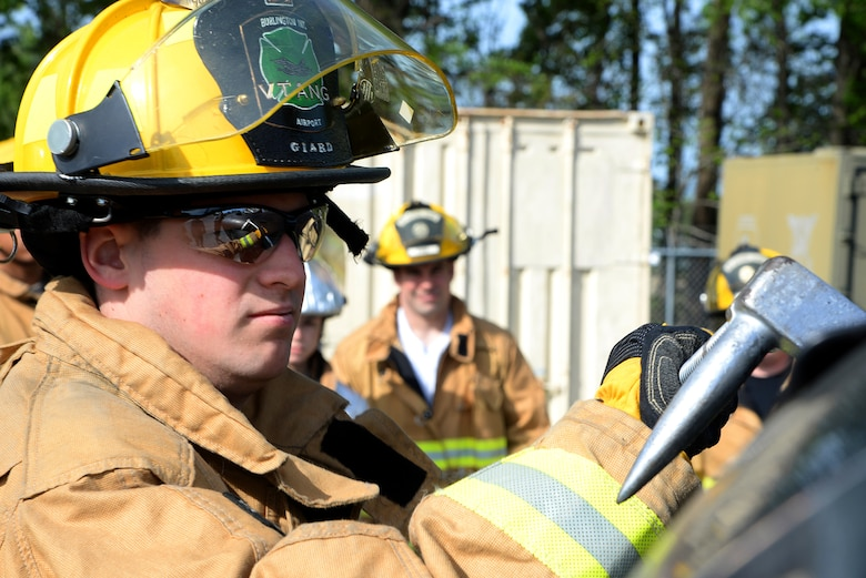 Airman 1st Class Evan Giard of the 158th Fighter Wing Fire Department, Vermont Air National Guard, utilizes a halligan tool to soften a vehicle during basic vehicle extrication training exercises at the 165th Airlift Wing's Regional Fire Training Facility in Savannah, Ga. on April 6th, 2016.  Airmen from the Connecticut, Maine, New Jersey, Rhode Island and Vermont Air National Guard Fire Departments are conducting training exercises together to maintain operational readiness. (U.S. Air National Guard photo by Tech. Sgt. Andrew J. Merlock/Released)