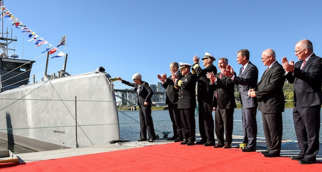 Deputy Defense Secretary Bob Work, second from left, celebrates during a Defense Advanced Research Projects Agency christening ceremony for a technology demonstration vessel in Portland, Ore., April 7, 2016. DARPA's anti-submarine warfare continuous trail unmanned vessel, or ACTUV, program, designed, developed and built the vessel. DoD photo by Army Sgt. 1st Class Clydell Kinchen