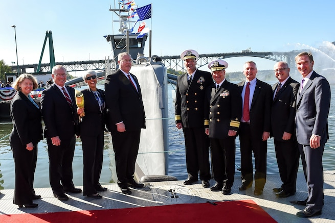 Deputy Defense Secretary Bob Work, center left, poses for a photograph after a Defense Advanced Research Projects Agency christening ceremony for a technology demonstration vessel in Portland, Ore., April 7, 2016. DoD photo by Army Sgt. 1st Class Clydell Kinchen