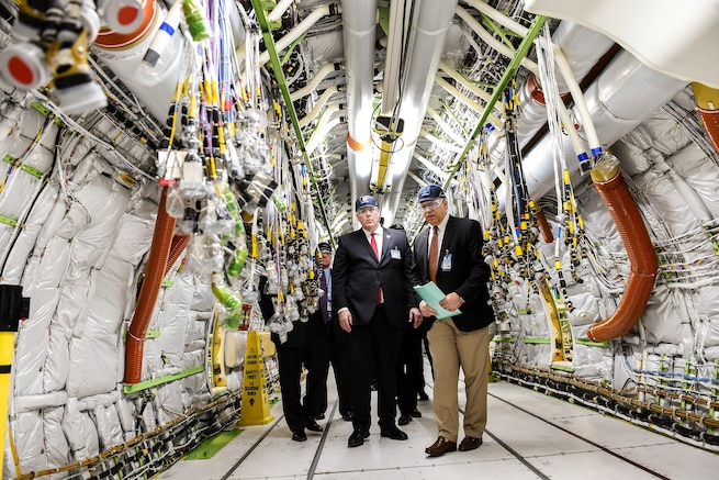 Deputy Defense Secretary Bob Work, left, tours the P-8 specific final installation bay and the P-8 in Renton, Wash., April 7, 2016. The P-8A Poseidon aircraft, derived from the next-generation 737-800, is designed for long-range anti-submarine warfare, anti-surface warfare and intelligence, surveillance and reconnaissance missions. DoD photo by Army Sgt. 1st Class Clydell Kinchen