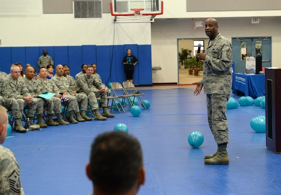 Chief Master Sgt. Michael McMillan, 36th Wing command chief, speaks about sexual assault prevention and response during an awareness rally April 1, 2015, at Andersen Air Force Base, Guam. April is recognized as Sexual Assault and Awareness Prevention month, which is dedicated to raising awareness and educating Airmen and their families about prevention methods. (U.S. Air Force photo/Airman 1st Class Alexa Ann Henderson/Released)