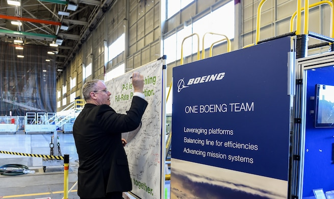 Deputy Defense Secretary Bob Work signs a canvas at the P-8 specific final installation bay in Renton, Wash., April 7, 2016. DoD photo by Army Sgt. 1st Class Clydell Kinchen