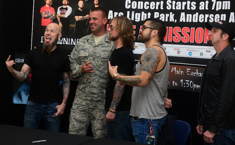 Members of the rock band Drowning Pool met with Team Andersen members April 6, 2016, at Andersen Air Force Base, Guam. Fans had the chance to take photos and receive autographs from the band.  (U.S. Air Force photo by Senior Airman Joshua Smoot)