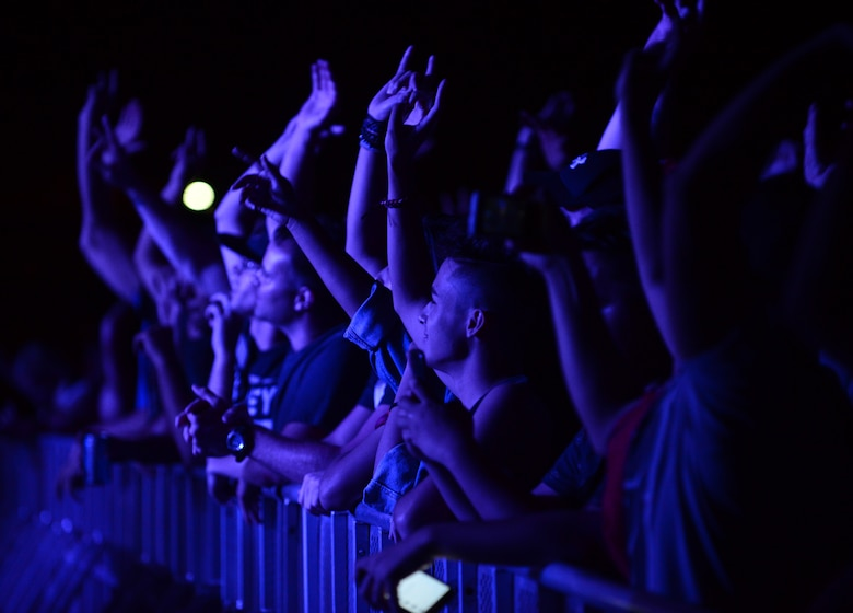 "Fans cheer during the Drowning Pool concert April 6, 2016, at Andersen Air Force Base, Guam. During the concert, Drowning Pool performed hit singles including ""Bodies"". (U.S. Air Force photo by Senior Airman Joshua Smoot)"