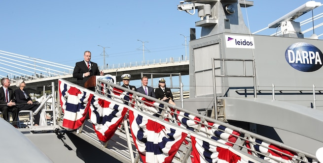 Deputy Defense Secretary Bob Work delivers remarks during a Defense Advanced Research Projects Agency christening ceremony for a technology demonstration vessel in Portland, Ore., April 7, 2016. DARPA's anti-submarine warfare continuous trail unmanned vessel, or ACTUV, program, designed, developed and built the vessel. DoD photo by Army Sgt. 1st Class Clydell Kinchen