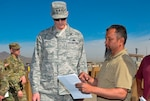 Francisco Alvarez, a DLA Disposition Services property disposal specialist, briefs DLA Director Air Force Lt. Gen. Andy Busch on the progress of the divestiture of Army property over to DLA Distribution and DLA Disposition Services during his April 5 visit to Fort Bliss, Texas.