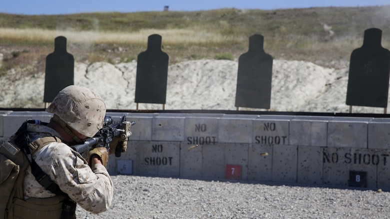 Corporal Michael Gray, Anti-Tank Missileman with 1st Light Armored Reconnaissance Battalion and student with the Urban Leaders Course, fires his M4 Carbine on burst during a combat marksmanship program range at Marine Corps Base Camp Pendleton, California, March 31, 2016. The ULC – run by 1st Marine Division Schools – is a three-week course to teach small unit leaders the skills and abilities they need to conduct combat operations in an urban environment.