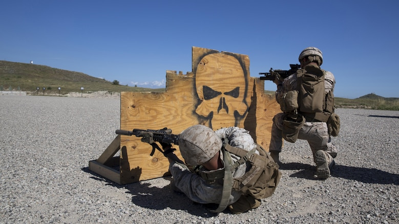 Lance Cpl. Daniel Lopez (right), and Lance Cpl. Corey Johnson, both mortarmen with Weapons Company, 3rd Battalion, 1st Marine Regiment, 1st Marine Division and students with the Urban Leaders Course, fire their M4 carbines from behind a barricade during a combat marksmanship program range at Camp Pendleton March 31, 2016. This range is the first live-fire range of the three-week course, and is designed to hone Marines' combat marksmanship skills including how to shoot, move and communicate with a buddy.