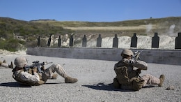 Cpl. Richard Nedlic (Right), Light Armored Vehicle crewman and Cpl. Nicholas Guiles, rifleman, both with 1st Light Armored Reconnaissance Battalion and students in the Urban Leaders Course, fire their weapons from the supine position during a combat marksmanship program range at Marine Corps Base Camp Pendleton, California, March 31, 2016. This firing drill is meant to train Marines to safely and accurately return fire if they fall backward while moving or are knocked down.