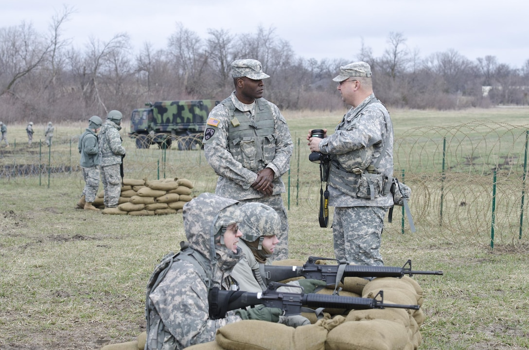 U.S. Army Reserve  Sgt. Joe Villines, with the 203rd Public Affairs Detachment, provides instructional training on camera equipment to a new Soldier at Camp Dodge, Iowa, March 18, 2016. Villines manages to find the balance between his military obligations, his civilian career with the Department of Veterans affairs, fatherhood, and a growing passion in rural farming. Joe is increasing his knowledge on traditional farming and becoming a man of the soil, and in the process giving back to his local community.(U.S. Army Reserve photo by  Brian Godette, USARC Public Affairs)