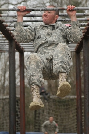 U.S. Army Sgt. 1st Class Jeremy Childers, assigned to Army Reserve Careers Division, does a pull up after completing the Obstacle Course event during the joint Best Warrior Competition hosted by 84th Reserve Training Command at Ft. Knox, Ky., March 23, 2016. The Best Warrior Competition is a four-day competition that tests competitors' Army aptitude by going through urban warfare situations, board interviews, physical fitness tests, written exams, Warrior tasks and battle drills relevant to today's operational environment. (U.S. Army photo by Spc. Josephine Carlson/Released)