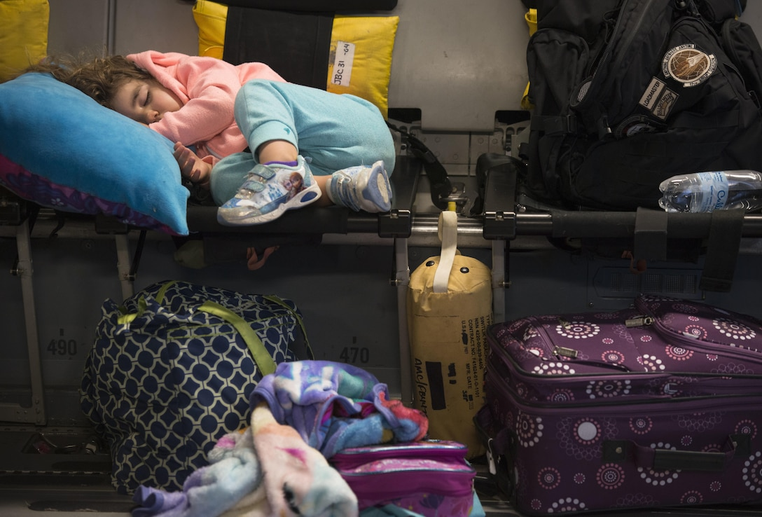 Amelia McNab, 2, sleeps on a seat inside a C-17 Globemaster III at Baltimore Washington International Airport, Md., April 1, 2016. Amelia is the daughter of two military parents. Defense Department dependents in Adana, Izmir and Mugla, Turkey, were given an ordered departure by the State Department and secretary of defense. (U.S. Air Force photo/Staff Sgt. Andrew Lee)
