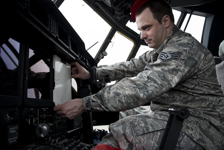 Staff Sgt. Matthew Farmer, 352d Special Operations Aircraft Maintenance Squadron Aerospace Propulsion Craftsman, outfits an MC-130J Commando II's Color Multi-Purpose Display with a 3D printed cover on RAF Mildenhall, April 8, 2016. Farmer designed the covers to protect the $70k screens from damage occurring during routine maintenance. Farmer submitted his ideas through the Airmen Powered by Innovation program and was notified that both were approved with a plan to implement. (U.S. Air Force photo by 1st Lt Chris Sullivan/Released)