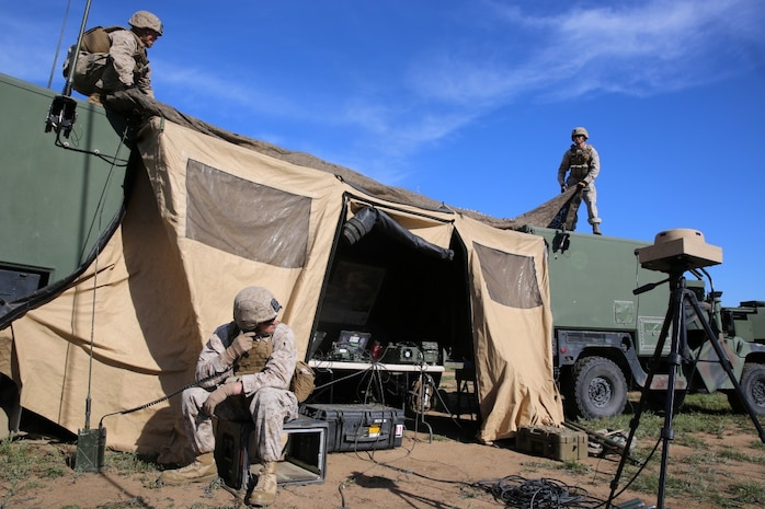 MARINE CORPS BASE CAMP PENDLETON, Calif. - Marines with Battery Q, 5th Battalion, 11th Marine Regiment, I Marine Expeditionary Force, set up the Fire Direction Center during Spring Fire Exercise at Camp Pendleton March 31, 2016. To ensure readiness, fire missions were coordinated and called at random intervals by the headquarters element. The Marines manning the artillery weapons were ready to fire swiftly and accurately upon command during the combined-arms training exercise. (U.S. Marine Corps Photo by Cpl. Demetrius Morgan/RELEASED)