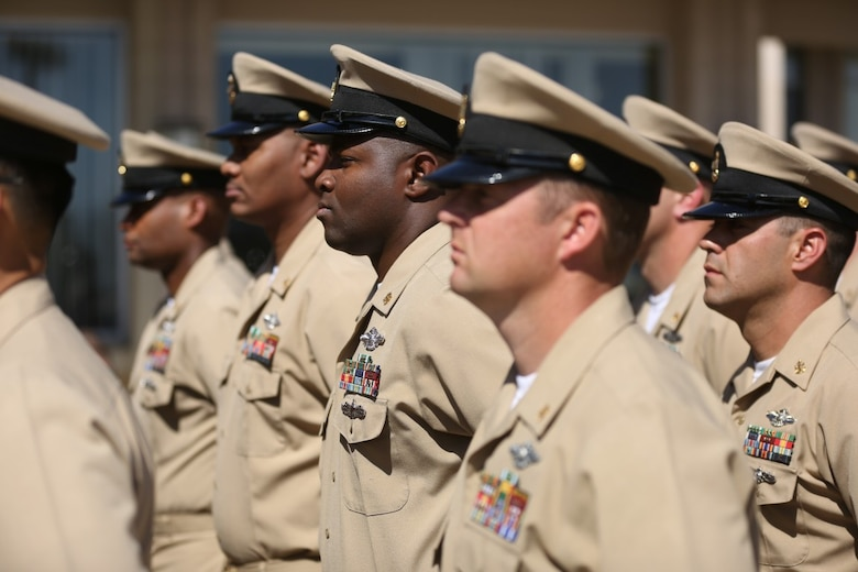 MARINE CORPS BASE CAMP PENDLETON, Calif. – Chief petty officers stand in formation during a dedication ceremony of Camp Pendleton's 'Anchor Up Club' as a Chiefs Mess to the North County Chief Petty Officer Association on April 1, 2016, at Camp Pendleton. Marines with I Marine Expeditionary Force Headquarters Group, dedicated the club in celebration of the 123rd birthday of chief petty officers throughout the Navy. A Chiefs Mess is a lounge and living quarters area typically designated for chief petty officers aboard boats, ships, and Naval Air Stations. (U.S. Marine Corps photo by Cpl. Angel Serna/Released)