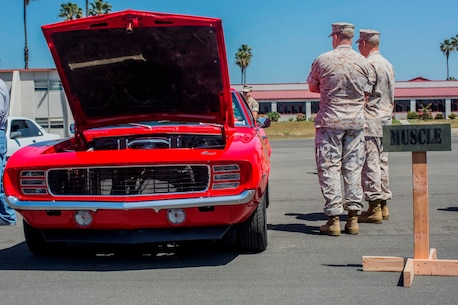 MARINE CORPS BASE CAMP PENDLETON, Calif. – Marines and sailors judge vehicles entered in a car show sponsored by I Marine Expeditionary Force Headquarters Group, April 1, 2016. Marines and Sailors entered their vehicles in support of a I MHG Marine Corps Ball fundraiser. (U.S. Marine Corps photo by Sgt. Tony Simmons/Released)