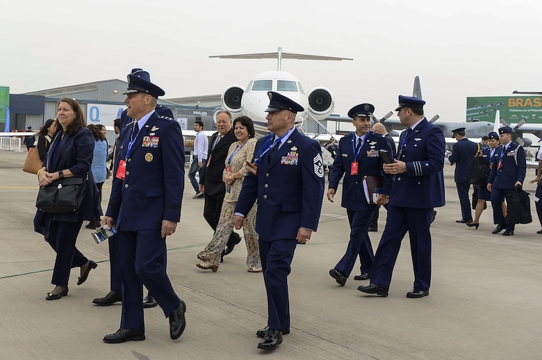 Lt. Gen. Chris Nowland, 12th Air Force (Air Forces Southern) commander, and Chief Master Sgt. Jose Barraza, 12 AF (AFSOUTH) command chief, head into the exhibition center during the opening of the 2016 International Air and Space Fair (FIDAE) in Santiago, Chile, March 29, 2016. Airmen from around the U.S. are scheduled to participate in a variety of activities during the week-long air show that includes aerial demonstrations, interaction with the local community, and subject matter expert exchanges with the Chilean air force. (U.S. Air Force photo by Tech. Sgt. Heather Redman/Released)