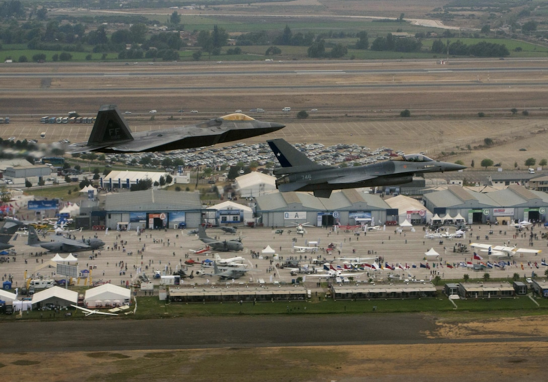 An F-22 Raptor, from the F-22 Demonstration Team at Langley AFB, Va., flies in formation with a Chilean F-16 Fighting Falcon over the 2016 International Air and Space Fair (FIDAE) in Santiago, Chile, April 1, 2016, 2016. During the FIDAE Air and Space Trade Show, U.S. Airmen participated in several subject matter expert exchanges with their Chilean counterparts and also hosted static displays and aerial demonstrations to support the air show.  (U.S. Air Force photo by Senior Airman Danny Rangel/Released)