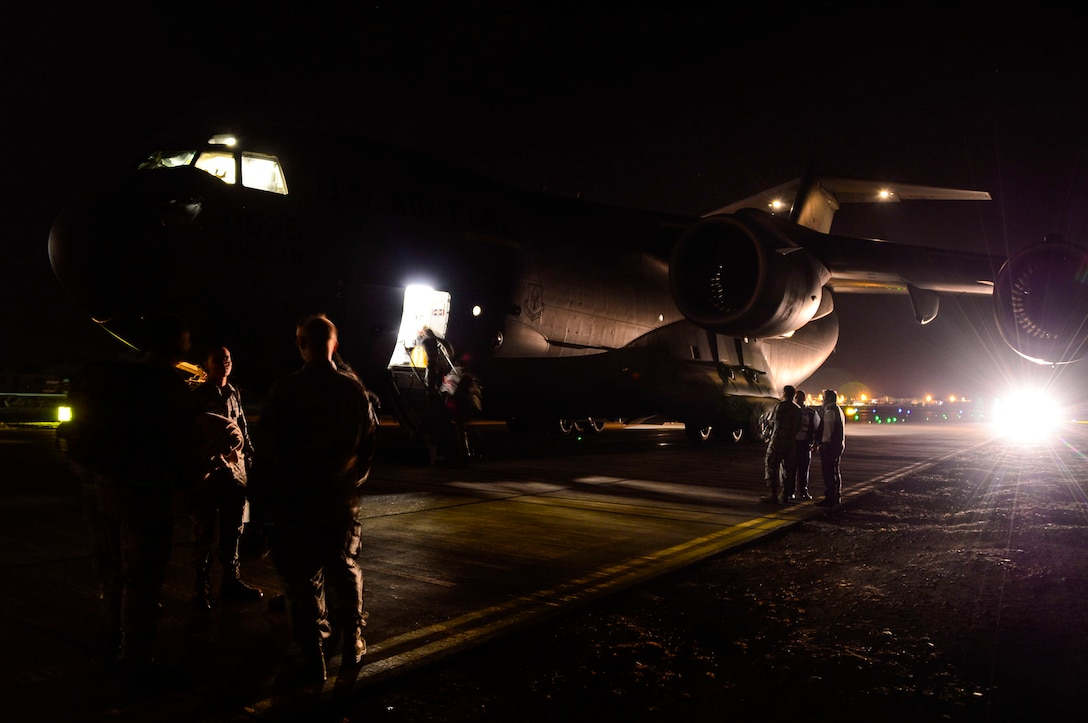 U.S. Airmen, from Wright-Patterson AFB, Ohio, disembark a C-17 Globemaster III in Santiago, Chile, for the 2016 International Air and Space Fair (FIDAE), March 27, 2016.  Airmen from around the U.S. are scheduled to participate in a variety of activities during the week-long air show that includes aerial demonstrations, interaction with the local community, and subject matter expert exchanges with the Chilean air force. (U.S. Air Force photo by Tech. Sgt. Heather Redman/Released)