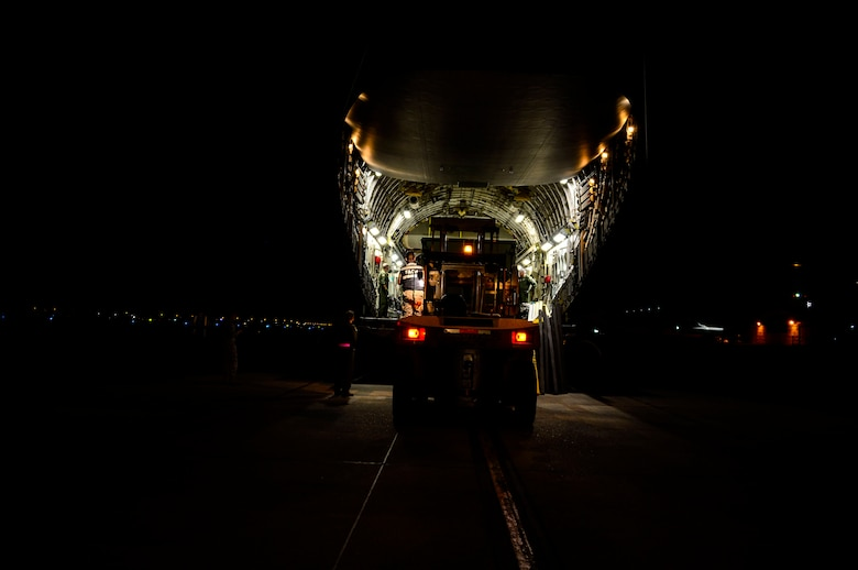 U.S. Airmen, from Wright-Patterson AFB, Ohio, work with Chilean airmen to unload a C-17 Globemaster III in Santiago, Chile, for the 2016 International Air and Space Fair (FIDAE), March 27, 2016.  Airmen from around the U.S. are scheduled to participate in a variety of activities during the week-long air show that includes aerial demonstrations, interaction with the local community, and subject matter expert exchanges with the Chilean air force. (U.S. Air Force photo by Tech. Sgt. Heather Redman/Released)