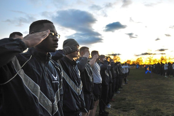 Airmen assigned to the 70th Intelligence, Surveillance and Reconnaissance Wing render a salute as revile is played before beginning the 2016 Sexual Assault, Awareness and Prevention Month garrison run April 8, 2016 at Fort George G. Meade, Md. There were over 1,900 joint service members participating in the SAAPM event. (U.S. Air Force photo/Staff Sgt. Alexandre Montes)